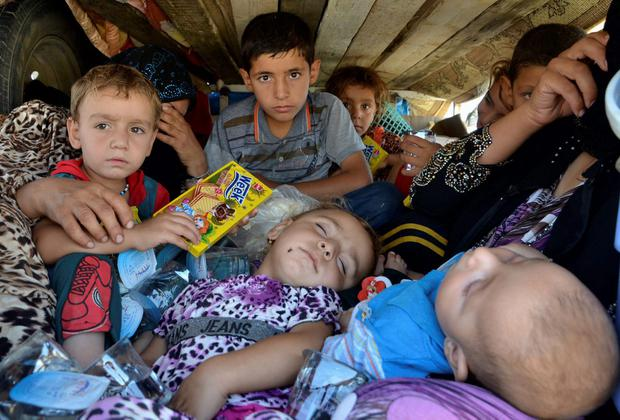 Displaced people, who fled from the violence in the province of Nineveh, arrive at Sulaimaniya province. The United States began to drop relief supplies to beleaguered Yazidi refugees fleeing Islamist militants in Iraq, but there was no immediate sign on Friday of U.S. air strikes to halt the sweeping advance of Islamic State fighters. (REUTERS/Stringer)