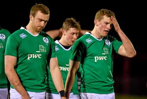 A dejected Stephen Fitzgerald, right, Ireland, after the final whistle