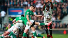 England's Maro Itoje charges down a kick from Ireland's Conor Murray