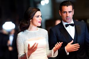 """British actress Rachel Weisz (L) talks with Irish actor Colin Farrell as they arrive for the screening of the film """"The Lobster"""" at the 68th Cannes Film Festival"""