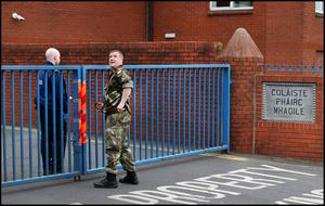 Gardai and members of the army at the grounds of Moyle Park College in Clondalkin where a door fell off an army helicopter. Photo by Steve Humphreys, 21st May 2020