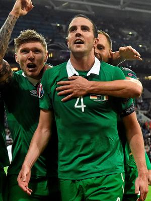 Jeff Hendrick celebrates with John O'Shea after setting up the defender for Ireland's equaliser in Gelsenkirchen