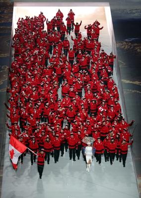 Ice hockey player Hayley Wickenheiser of the Canada Olympic team carries her country's flag during the Opening Ceremony of the Sochi 2014 Winter Olympics