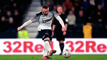 Derby County's Wayne Rooney scores his side's fourth goal of the game from a penalty during the FA Cup fourth round replay win over Northampton match at Pride Park, Derby. Photo: Mike Egerton/PA Wire