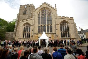 Members of the public gather outside St Mary's Church in Bury St Edmunds, Suffolk, for the wedding of former Coronation Street actress Michelle Keegan to The Only Way Is Essex star Mark Wright.  Yui Mok/PA Wire