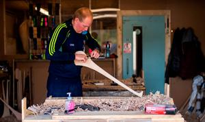 David Dowling shapes the hurl with a spokeshave at The Star Hurley in Jenkinstown, Kilkenny. Photo: Ramsey Cardy/Sportsfile