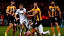 James Wilson of Manchester United battles for the ball with Josh Coulson of Cambridge United during the FA Cup Fourth Round match between Cambridge United and Manchester United