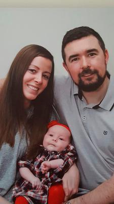 Four-month-old Lara McHugh with her father Niall McHugh and her mother Celine Power, who cried with joy when they got the good news