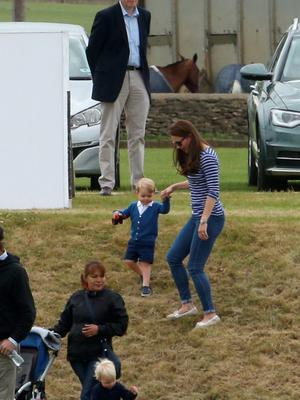The Duchess of Cambridge with Prince George (centre) as the Duke of Cambridge and Prince Harry take part in a charity polo match at Beaufort Polo Club in Tetbury, Gloucestershire. PRESS ASSOCIATION Photo. Picture date: Sunday June 14, 2015. Photo credit should read: Steve Parsons/PA Wire