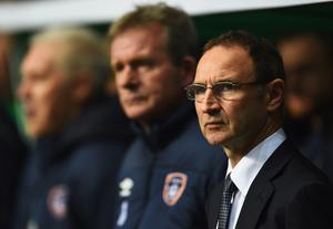 Martin O'Neill manager of the Republic of Ireland (R) looks on prior to the EURO 2016 Group D Qualifier match between Scotland and Republic of Ireland at Celtic Park