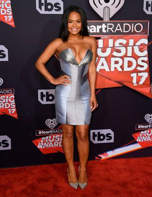 Christina Milian arrives at the iHeartRadio Music Awards at the Forum on Sunday, March 5, 2017, in Inglewood, Calif. (Photo by Jordan Strauss/Invision/AP)