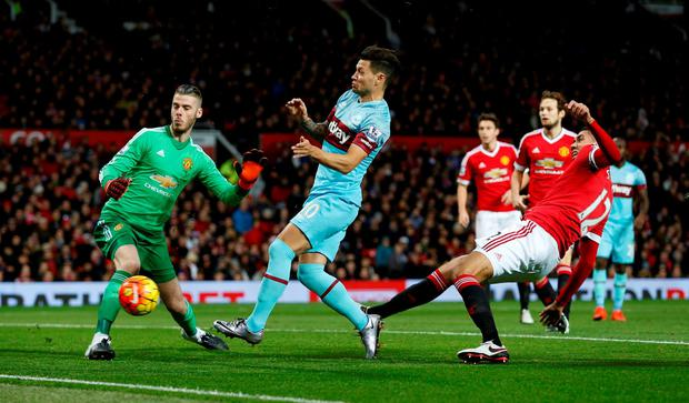 """Football Soccer - Manchester United v West Ham United - Barclays Premier League - Old Trafford - 5/12/15 Manchester United's David De Gea watches on as West Ham's Mauro Zarate shoots at goal Action Images via Reuters / Lee Smith Livepic EDITORIAL USE ONLY. No use with unauthorized audio, video, data, fixture lists, club/league logos or """"live"""" services. Online in-match use limited to 45 images, no video emulation. No use in betting, games or single club/league/player publications.  Please contact your account representative for further details."""
