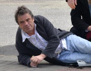 Film director Neil Jordan lays on the ground in pain