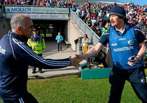 Galway manager Anthony Cunningham shakes hands with Laois manager Seamus Plunkett after the game