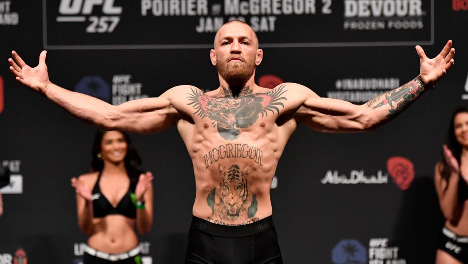 Conor McGregor poses on the scale during the UFC 257 weigh-in at Etihad Arena on UFC Fight Island in Abu Dhabi