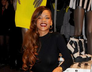 Rihanna makes an appearance at the River Island store in Oxford Street, London, to promote her new fashion line. PRESS ASSOCIATION Photo. Picture date: Monday March 4, 2013. Photo credit should read: Ian West/PA Wire