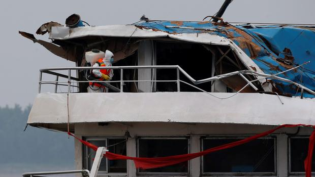 A rescue worker works on the salvaged cruise ship Eastern Star in the Jianli section of Yangtze River, Hubei province, China, June 7, 2015. REUTERS/Kim Kyung-Hoon