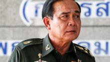 Thai army chief General Prayuth Chan-ocha listens to questions from the media during a news conference at the Army Club after the army declared martial law nationwide to restore order