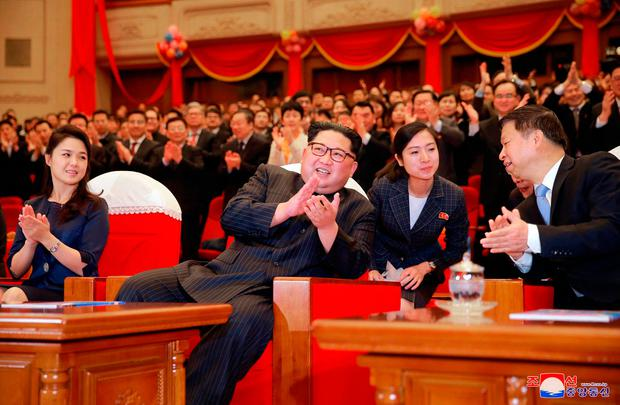 In this photo provided last Tuesday by the North Korean government, North Korean leader Kim Jong Un claps while watching a performance of a Chinese art troupe with his wife Ri Sol Ju, left, and Song Tao, right, head of the ruling Communist Party's international department, at East Pyongyang Grand Theatre in Pyongyang, North Korea. Photo: AP