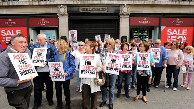 Former Clerys employees outside the iconic store on Dublins O'Connell street.  Picture;  GERRY MOONEY.  13/6/15