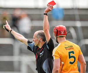 Atrim's Simon McCrory is sent off by referee Cathal McAllister