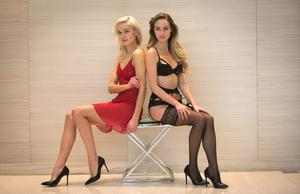 (L to r) Teo Sutra wearing Heidi Klum Intimates Valerie Chilli Pepper Chemise, Bra, Bikini & Daniella Moyles wearing Bluebella Vivienne Bra, Brief & Suspender as part of a showcase of Valentines Day Lingerie looks from the Lingerie Rooms at Brown Thomas.