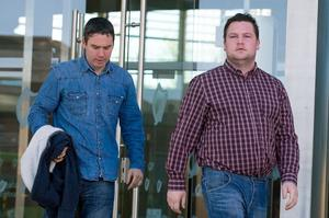 Film Maker Mark O'Connor (Left) and Love/Hate actor John Connors (right) leaving Dublin District Court after giving evidence in a unsuccessful bail hearing of Stephen Clinch who has been charged with robbery. Pic: Court Collins.