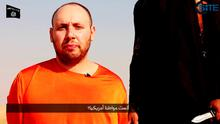 A video purportedly showing U.S. journalist Steven Sotloff kneeling next to a masked Islamic State fighter holding a knife in an unknown location in this still image from video released by Islamic State September 2, 2014