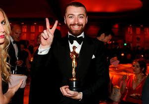 """British singer-songwriter Sam Smith, winner for Best Original Song for """"Writing's on the Wall"""" from the movie """"Spectre"""", gestures at the Governors Ball following the 88th Academy Awards in Hollywood, California February 28, 2016.  REUTERS/Lucy Nicholson"""