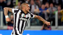Juventus' Arturo Vidal celebrates after scoring his side's first goal during the Champions League, quarterfinal, first leg soccer match between Juventus and Monaco.