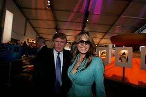 Donald and Melania Trump pose for photos in the lobby of the main tent during Olympus Fashion Week Fall 2005 at Bryant Park February 9, 2005 in New York City. (Photo by Katy Winn/Getty Images)