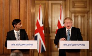 Britain's Prime Minister Boris Johnson and Chancellor of the Exchequer Rishi Sunak attend a news conference on the ongoing situation with the coronavirus disease (COVID-19) in London. Photo: Matt Dunham/Pool via REUTERS