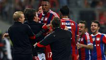 Bayern Munich's Jerome Boateng (C) celebrates with his team mates after scoring a goal against Manchester City  during their Champions League group E soccer match in Munich
