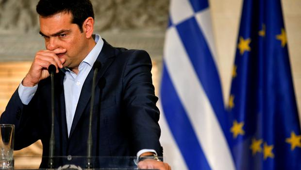 """Greek Prime Minister Alexis Tsipras gestures during a news conference with Austrian Chancellor Werner Faymann at Maximos Mansion in Athens June 17, 2015. The Greek central bank warned on Wednesday that the country would be put on a """"painful course"""" towards default and exiting the euro zone if the government and its international creditors failed to reach an agreement on an aid-for-reforms deal.  REUTERS/Paul Hanna        TPX IMAGES OF THE DAY"""