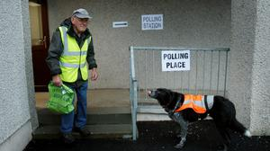 A voter arrives at Ritchie Hall polling station in Strichen, as Scotland goes to the polls to vote in the Scottish independence referendum. Danny Lawson/PA Wire