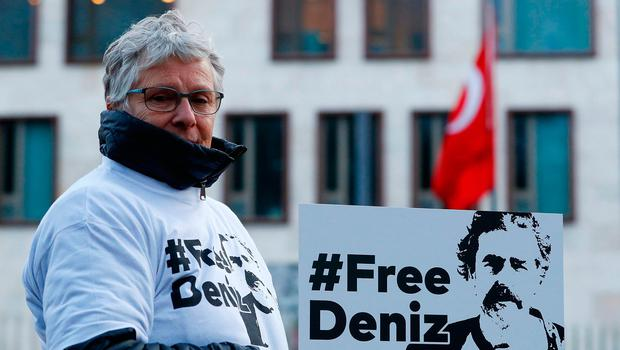 Protestors carry placards during a demonstration to support arrested German-Turkish journalist Deniz Yucel outside theTurkish Embassy in Berlin, Germany. REUTERS/Fabrizio Bensch