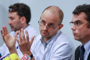 Jean-Francois Payen (C), head anaesthetician at the CHU hospital, neurosurgeon Stephan Chabardes (L) and Marc Penaud (R), hospital deputy general director, give a news conference at the CHU Nord hospital emergency unit in Grenoble, French Alps, where retired seven-times Formula One world champion Michael Schumacher is hospitalised after a ski accident