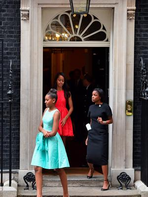 Malia (C) and Sasha Obama (L) leave Downing Street following a meeting with Prime Minister David Cameron and his wife Samantha Cameron on June 16, 2015 in London,England  (Photo by Jeff J Mitchell/Getty Images)
