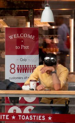 Hard times: A customer takes a break in a Pret a Manger outlet in central London yesterday. Photo: PA