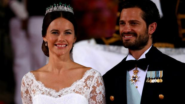 STOCKHOLM, SWEDEN - JUNE 13:  Prince Carl Philip of Sweden is seen with his new wife Princess Sofia of Sweden after their marriage ceremony on June 13, 2015 in Stockholm, Sweden.  (Photo by Andreas Rentz/Getty Images)