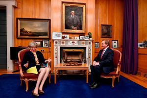 Under the watchful eye of Michael Collins's portrait, Prime Minister Theresa May meets Enda Kenny in Government Buildings. Photo: Charles McQuillan/Getty Images