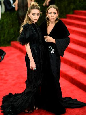 "Ashley Olsen and Mary Kate Olsen attend the ""China: Through The Looking Glass"" Costume Institute Benefit Gala at the Metropolitan Museum of Art on May 4, 2015 in New York City.  (Photo by Andrew H. Walker/Getty Images for Variety)"