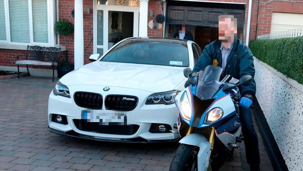 Gardai seize vehicles from Jonathan Dowdall during a raid on his home