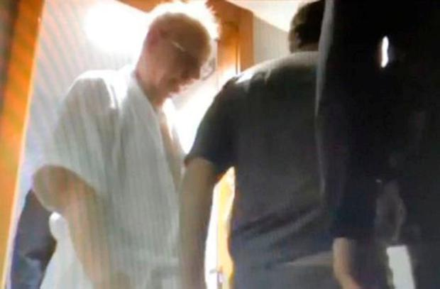 Pat Hickey is arrested in his dressing gown at a Rio hotel room in August 2016