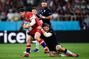 Russia's number 8 Nikita Vavilin is tackled by Scotland's lock Ben Toolis. Photo: ANNE-CHRISTINE POUJOULAT/AFP via Getty Images