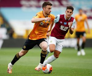 Wolves' Diogo Jota keeps possession ahead of Burnley's Ashley Westwood. Photo: Reuters