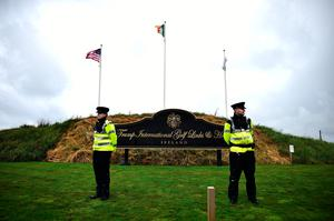 Gardai patrol outside the Trump golf resort as it prepares for the visit of US President Donald Trump