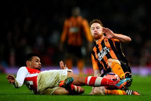 Francis Coquelin of Arsenal battles for the ball with Stephen Quinn of Hull City during the FA Cup Third Round match at the Emirates Stadium
