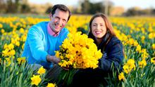 Darragh McCullough and Eleanor Meade with some of the flowers they distributed for the Irish Cancer Society, in Gormanston, Co Meath. Photo: Ciara Wilkinson