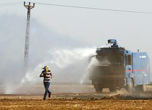 Security forces use water cannons to disperse Kurdish demonstrators at the Turkish-Syrian boder near the southeastern town of Suruc, who had gathered to support Syrian Kurds. Reuters